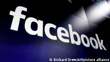 """FILE - This March 29, 2018 file photo shows the Facebook logo on screens at the Nasdaq MarketSite, in New York's Times Square. Individuals linked to Russia and the French military used fake Facebook and Instagram accounts to wage a covert disinformation campaign in the Central African Republic ahead of elections there this month, Facebook announced this week. Facebook said on Thursday, Dec. 17, 2020 it took down hundreds of accounts and groups linked to France and Russia accused of """"coordinated inauthentic behavior"""" in CAR as well as other countries in Africa and the Middle East. (AP Photo/Richard Drew, File)"""