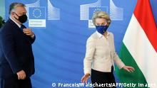 Hungarian Prime Minister Viktor Orban (L) is welcomed by European Commission President Ursula von der Leyen in the Berlaymont building at the EU headquarters in Brussels on April 23, 2021. (Photo by François WALSCHAERTS / various sources / AFP) (Photo by FRANCOIS WALSCHAERTS/AFP via Getty Images)