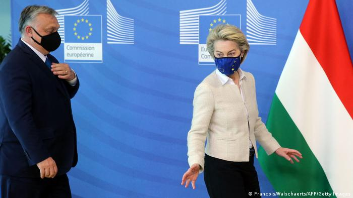 Hungarian Prime Minister Viktor Orban (L) is welcomed by European Commission President Ursula von der Leyen in the Berlaymont building at the EU headquarters in Brussels on April 23, 2021.
