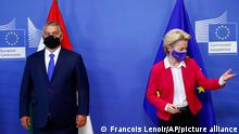 Hungary's Prime Minister Viktor Orban, left, and European Commission President Ursula von der Leyen pose for a photograph prior to a meeting with the Visegrad Group at EU headquarters in Brussels, Thursday, Sept 24, 2020. (Francois Lenoir, Pool via AP)