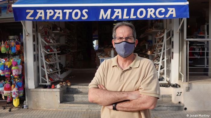 Shoe store proprietor Juan Jesus Bouzas in front of his shop in Mallorca