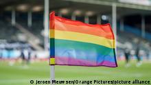 File photo: A rainbow flag on a football pitch.