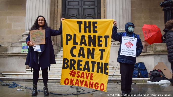 Greenpeace protesters in London holding up a banner