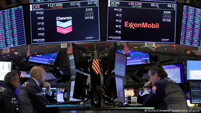 Traders sitting at their desks at the Stock Exchange in New York