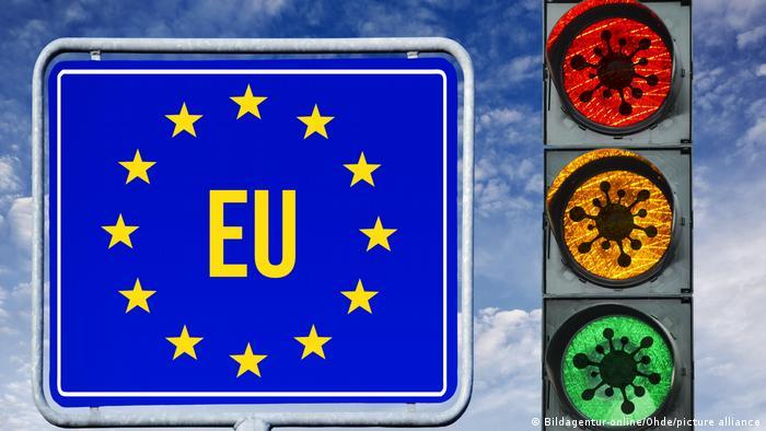 An EU road sign, next to a traffic light