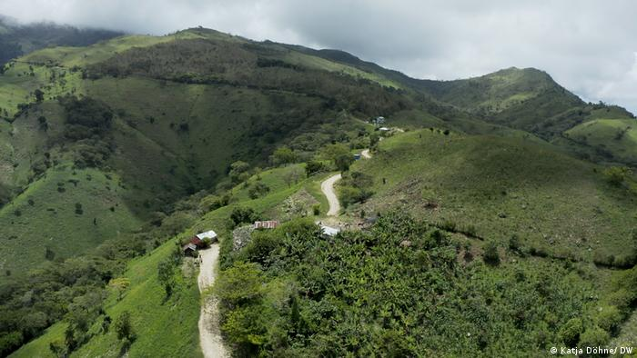 Aerial view of a small village in lush green mountains
