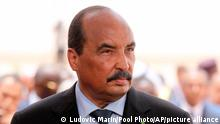 Mauritania's President Mohamed Ould Abdel Aziz wait for the arrival of his French counterpart Emmanuel Macron at Nouakchott airport, Mauritania, Monday, July 2, 2018. Macron, making an exceptional appearance at an African Union summit, is expected to discuss hurdles facing a five-nation French-backed anti-terror unit, the G5 Sahel force. . (Ludovic Marin/Pool Photo via AP)