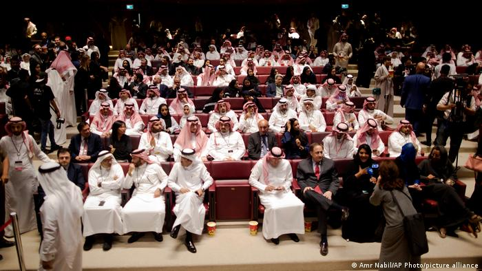Visitors attend a cinema theatre during an invitation-only screening, in Riyadh, Saudi Arabia.