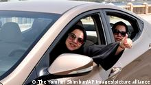 A woman drives with smile in Jeddah, Saudi Arabia on June 24, 2018. Saudi Arabia lifted the ban on prohibiting women to drive was lifted as a part of Saudi Arabia's Vision for 2030 Plan.( The Yomiuri Shimbun via AP Images )