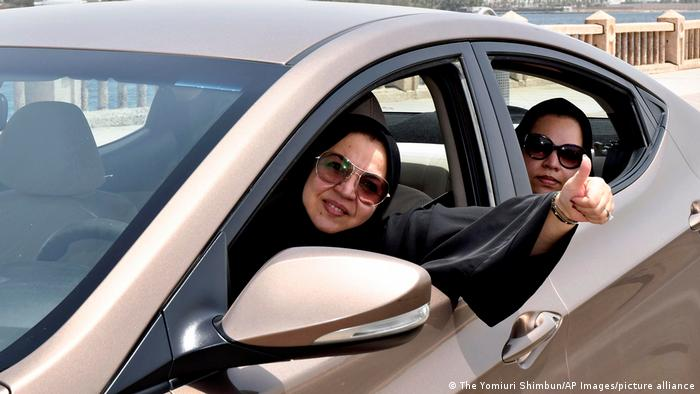 A woman drives with smile in Jeddah, Saudi Arabia.