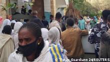 People gather as victims arrive at Ayder Referral Hospital, in Mekelle, after an airstrike in Togoga, Ethiopia's Tigray region June 22, 2021. Picture taken June 22, 2021. Tigray Guardians 24 via REUTERS MANDATORY CREDIT. NO RESALES. NO ARCHIVES. THIS IMAGE HAS BEEN SUPPLIED BY A THIRD PARTY.