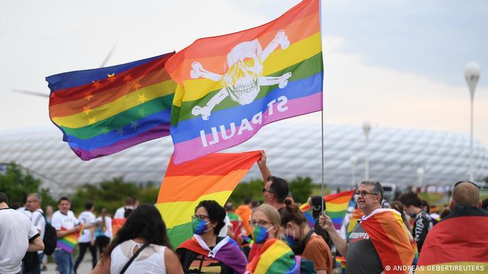 Fans outside Munich's Allianz Arena wave rainbow flags