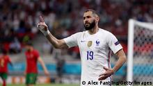 BUDAPEST, HUNGARY - JUNE 23: Karim Benzema of France reacts after the linesman gives his goal as on offside. After a VAR check the goal stands and France score their second goal during the UEFA Euro 2020 Championship Group F match between Portugal and France at Puskas Arena on June 23, 2021 in Budapest, Hungary. (Photo by Alex Pantling/Getty Images)