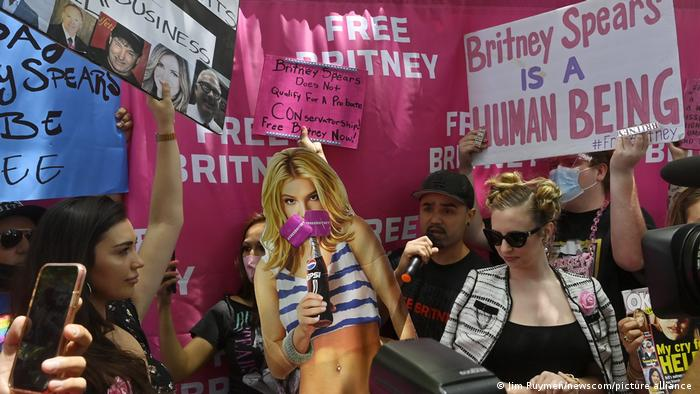 Fans and supporters of Britney Spears holding up signs