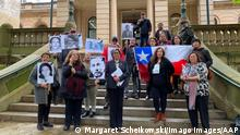 Supporters of those who disappeared in Chile in 1970s are seen outside the Sydney Central Local Court in Sydney