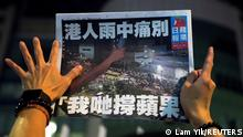 A supporter gestures while holding the final edition of Apple Daily in Hong Kong, China June 24, 2021. REUTERS/Lam Yik TPX IMAGES OF THE DAY