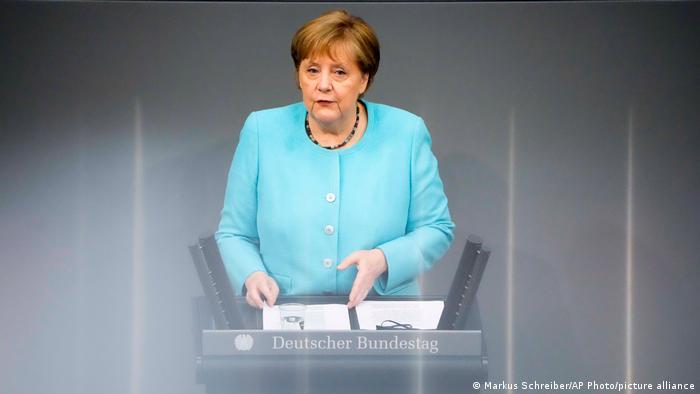 German Chancellor Angela Merkel speaks at the Bundestag in Berlin