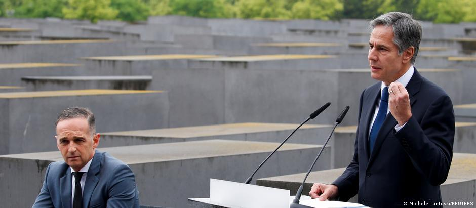 U.S. Secretary of State Blinken speaks next to German Foreign Minister Heiko Maas during a visit at Holocaust Memorial