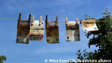 Illustration photo, How criminals clean their dirty money, launder money, laundering. Euro Bank notes hanging on a clothesline. (CTK Photo/Milos Ruml)