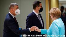 Czech Republic's Prime Minister Andrej Babis, left, greets Germany's Chancellor Angela Merkel during an EU summit at the European Council building in Brussels, Thursday, June 24, 2021. At their summit in Brussels, EU leaders are set to take stock of coronavirus recovery plans, study ways to improve relations with Russia and Turkey, and insist on the need to develop migration partners with the countries of northern Africa, but a heated exchange over a new LGBT bill in Hungary is also likely. (AP Photo/Olivier Matthys, Pool)