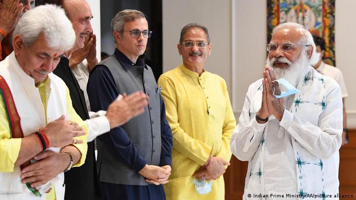 Indian Prime Minister Narendra Modi greets Kashmiri politicians before the start of their meeting in New Delhi on Thursday