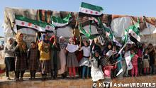 Internally displaced Syrian girls hold Syrian opposition flags during a protest against the closure of Bab al-Hawa crossing in the opposition-held Idlib, Syria June 7, 2021. Picture taken June 7, 2021. REUTERS/Khalil Ashawi