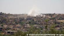 Smoke billows following reported bombardment by government forces in the Syrian northwestern town of Barah, in the Jabal al-Zawiya region of the rebel-held Idlib province on June 21, 2021. - Syrian government shelling on the rebel-controlled enclave of Idlib killed at least nine people, including four civilians, a war monitor reported. (Photo by Abdulaziz KETAZ / AFP) (Photo by ABDULAZIZ KETAZ/AFP via Getty Images)