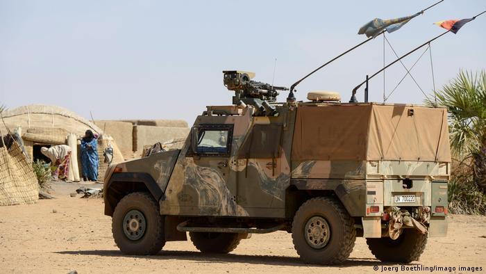 german army Bundeswehr, patrol with Eagle Mowag armored vehicle in village