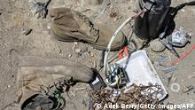 This picture taken on June 17, 2021, shows used boots and other items at a junkyard near the Bagram Air Base in Bagram. - The Pentagon is evacuating Bagram airbase as part of its plan to withdraw all forces by this year's 20th anniversary of the September 11 attacks on the US, taking military gear home or given to Afghan security forces, but tons of civilian equipment must be left behind. - TO GO WITH 'Afghanistan-USA-conflict-Bagram' FOCUS by Anne CHAON and Mushtaq MOJADDIDI (Photo by Adek BERRY / AFP) / TO GO WITH 'Afghanistan-USA-conflict-Bagram' FOCUS by Anne CHAON and Mushtaq MOJADDIDI (Photo by ADEK BERRY/AFP via Getty Images)