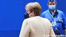 25.06.21 *** Germany's Chancellor Angela Merkel departs on the second day of a EU summit at the European Council building in Brussels, Belgium June 25, 2021. John Thys/Pool via REUTERS