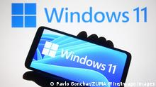 June 24, 2021, Ukraine: In this photo illustration a Windows 11 logo is seen on a smartphone and a pc screen in the background..Microsoft has presented Windows 11, new generation of Windows operating system OS, during an event on June 24, 2021. Ukraine - ZUMAs197 20210624_zaa_s197_177 Copyright: xPavloxGoncharx