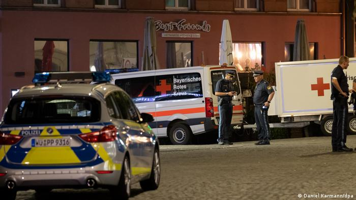 Police and red cross vehicles responding at the scene in Würzburg on the night of the attack: Friday, June 25, 2021