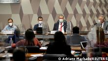 Employee of the Ministry of Health, Luis Ricardo Fernandes Miranda, Brazilian Federal Deputy Luis Miranda, senator Omar Aziz and senator Renan Calheiros attend a meeting of the Parliamentary Inquiry Committee (CPI) to investigate government actions and management during the coronavirus disease (COVID-19) pandemic, at the Federal Senate in Brasilia, Brazil June 25, 2021. REUTERS/Adriano Machado