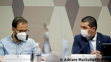 Employee of the Ministry of Health, Luis Ricardo Fernandes Miranda and Brazilian Federal Deputy Luis Miranda attend a meeting of the Parliamentary Inquiry Committee (CPI) to investigate government actions and management during the coronavirus disease (COVID-19) pandemic, at the Federal Senate in Brasilia, Brazil June 25, 2021. REUTERS/Adriano Machado