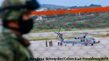 The Colombian presidential helicopter sits at the tarmac of the Camilo Daza International Airport after being hit by gunfire in Cucuta, Colombia on June 25, 2021. - Colombian President Ivan Duque said Friday the helicopter he was flying in near the border with Venezuela was hit by gunfire. It is a cowardly attack, where you can see bullet holes in the presidential aircraft, Duque said in a statement. (Photo by Schneyder MENDOZA / Colombian Presidency / AFP)