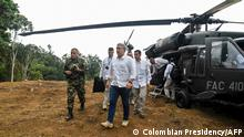 (FILES) Handout file photo taken on August 09, 2019 and released by the Colombian Presidency of President Ivan Duque (C), walking after getting off a helicopter at a coca plantation in Catatumbo, southern Colombia. - Colombian President Ivan Duque said on June 25, 2021 that the helicopter he was flying in near the border with Venezuela was hit by gunfire. It is a cowardly attack, where you can see bullet holes in the presidential aircraft, Duque said in a statement. (Photo by - / Colombian Presidency / AFP) / RESTRICTED TO EDITORIAL USE - MANDATORY CREDIT AFP PHOTO / COLOMBIAN PRESIDENCY - NO MARKETING NO ADVERTISING CAMPAIGNS - DISTRIBUTED AS A SERVICE TO CLIENTS