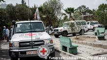 Ambulances of Red Cross arrive with patients who were injured in their town Togoga in a deadly airstrike on a market, arrive at Mekelle General Hospital in Mekele, on June 24, 2021, two days after a deadly airstrike on a market in Ethiopia's war-torn northern Tigray region, where a seven-month-old conflict surged again. - At least 64 people were killed and 180 were injured in an air strike on a market in Ethiopia's war-torn northern Tigray region, a local health officer said, as the army denied targeting civilians. (Photo by Yasuyoshi CHIBA / AFP) (Photo by YASUYOSHI CHIBA/AFP via Getty Images)