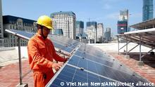 A worker of EVN Hanoi installs panels for solar electricity production for poor households in the capital city's suburban Quoc Oai District. According to McKinsey & Company, renewables are potentially the lowest-cost option for Vietnam to meet its energy needs.