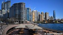This picture shows a closed restaurant next to the harbour in Sydney on June 26, 2021, after authorities locked down several central areas of Australia's largest city to contain an outbreak of the highly contagious Delta variant. (Photo by Saeed KHAN / AFP)