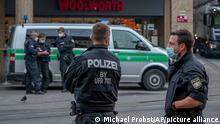 Police officers secure the crime scene in central Wuerzburg, Germany, Saturday, June 26, 2021. German police say several people have been killed and others injured in a knife attack in the southern city of Wuerzburg on Friday.(AP Photo/Michael Probst)