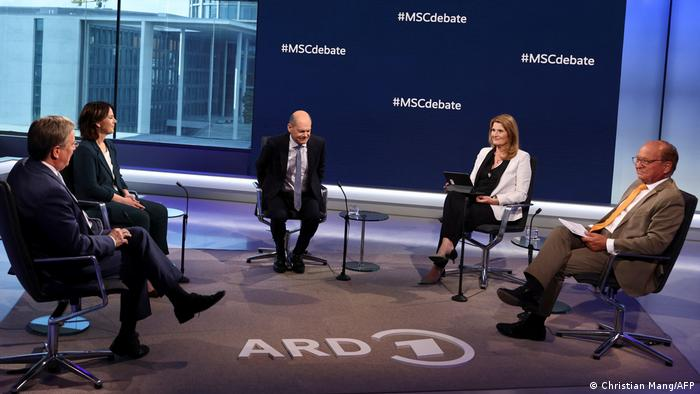 German Christian Democratic Union (CDU) leader Armin Laschet, Green party co-leader Annalena Baerbockand German Finance Minister Olaf Scholz of the Social Democratic Party (SPD) attend a television debate hosted by tv moderator Tina Hassel and German diplomat and Chair of the Munich Security Conference Wolfgang Ischinger in Berlin Saturday