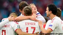AMSTERDAM, NETHERLANDS - JUNE 26: Kasper Dolberg of Denmark celebrates with team mates after scoring their side's second goal during the UEFA Euro 2020 Championship Round of 16 match between Wales and Denmark at Johan Cruijff Arena on June 26, 2021 in Amsterdam, Netherlands. (Photo by Olaf Kraak - Pool/Getty Images)