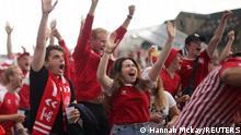 Soccer Football - Euro 2020 - Fans gather in fan zone for Wales v Denmark - Copenhagen, Denmark - June 26, 2021 Denmark fans celebrate REUTERS/Hannah Mckay