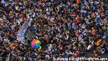 Members of the LGBTQ+ community march with rainbow flags and a banner as Turkish police block their way during the Gay Pride parade in Istanbul, on June 30, 2019. - Turkish police on June 30 fired tear gas at gay rights groups and activists who defied authorities to march for the Istanbul pride parade, banned for the fifth year in a row. Thousands of people rallied close to the popular Istiklal Avenue and Taksim Square where organisers originally planned to hold the parade, an AFP correspondent said. (Photo by BULENT KILIC / AFP) (Photo credit should read BULENT KILIC/AFP via Getty Images)