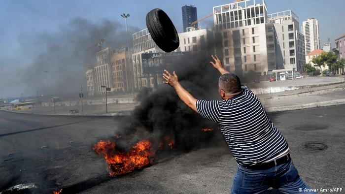 Demonstrators burn tires to block the Martyrs' Square in the centre of Lebanon's capital Beirut