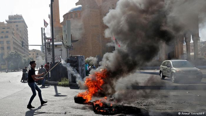 Demonstrators burn tires to block the Martyrs' Square in the center of Lebanon's capital Beirut