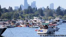 People in boats party on Lake Washington during a heat wave in Seattle, Washington, U.S., June 26, 2021. REUTERS/Karen Ducey