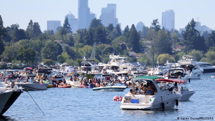 People in boats party on Lake Washington during a heat wave in Seattle