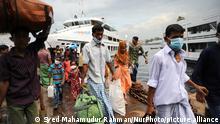 Migrant workers reach Sadarghat Launch Terminal in Dhaka, Bangladesh on May 25, 2021. (Photo by Syed Mahamudur Rahman/NurPhoto)