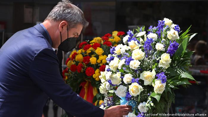 Bavarian state premier Markus Söder lays a wreath at the site of a deadly knife attack in Würzburg